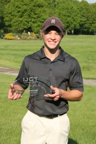 Holden Pahr holds championship trophy