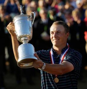 Jordan Spieth holds up the trophy after winning the U.S. Open golf tournament at Chambers Bay on Sunday, June 21, 2015 in University Place, Wash. (AP Photo/Ted S. Warren)