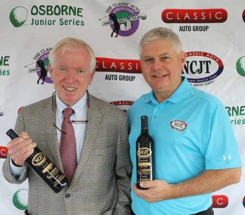 Jim Brown with Tony Milam at NCJT's Trophy Pick-up event at Classic BMW on October 25, 2014.